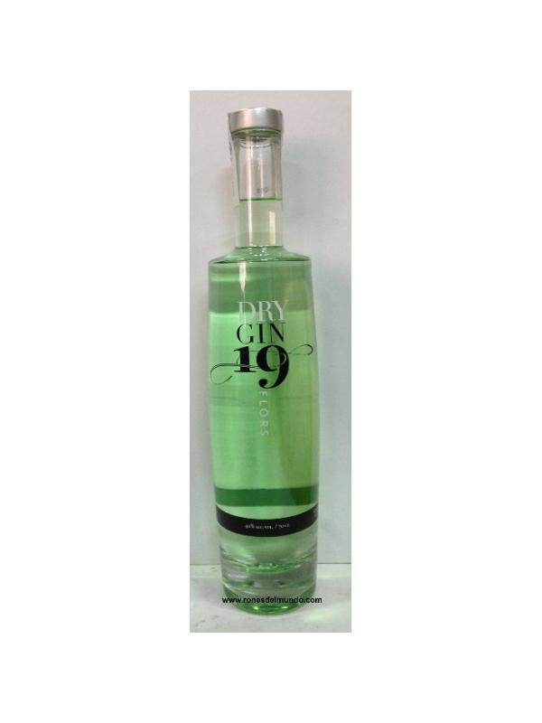 GINEBRA DRY GIN 19 FLORS - GINEBRA DRY GIN 19 FLORS Es una ginebra catalana singular, obtenida a partir de la destilación artesanal en pequeños alambiques de no mad de 100 litros.