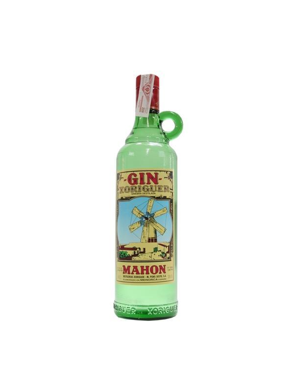 GINEBRA XORINGER 70 cl - Gin Xoriguer es suave, fino y seco con marcado sabor a enebro y el delicadísimo sabor a madera.  Su sabor profundo permanece delicadamente en la boca.  Su transparencia no miente y revela las cualidades del aguardiente